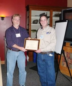 ALCor Brian Reasor awarding Ian Hewitt a certificate for completing the Herschel 400
